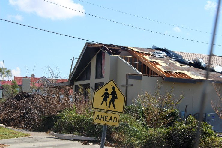 church with roof damaged in Hurricane Matthew