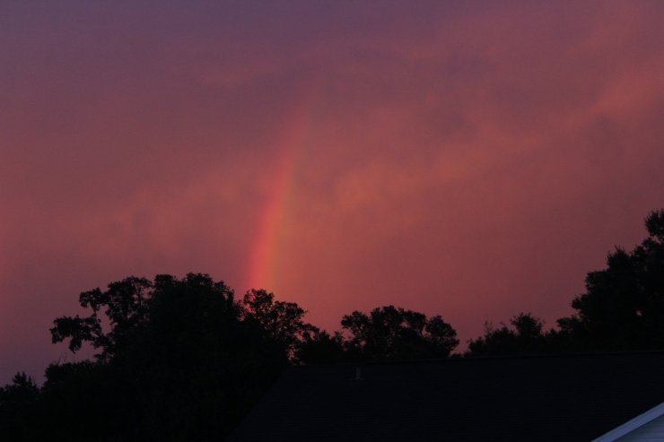 rainbow in a red evening sky